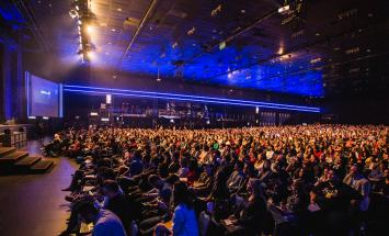 large conference hall filled with people in seats